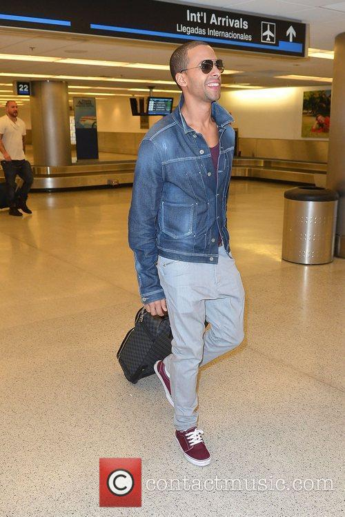Marvin Humes JLS arrive at Miami International Airport...