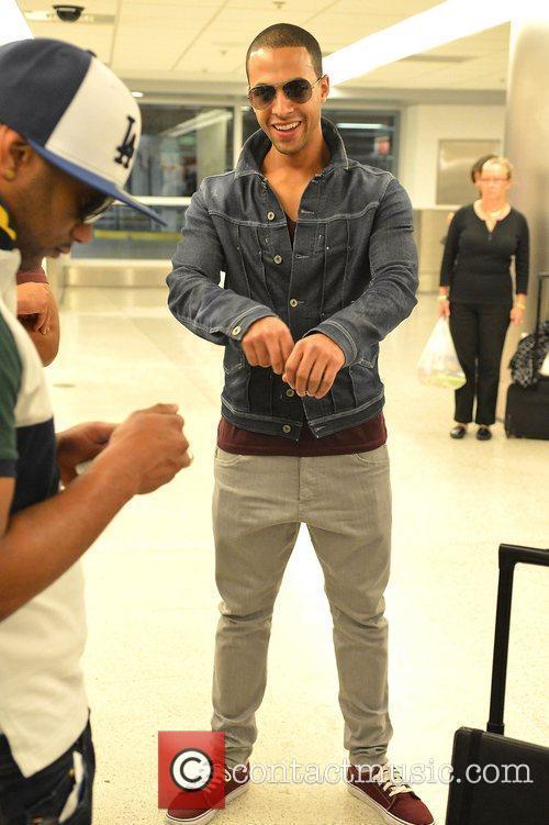 JLS arrive at Miami International Airport