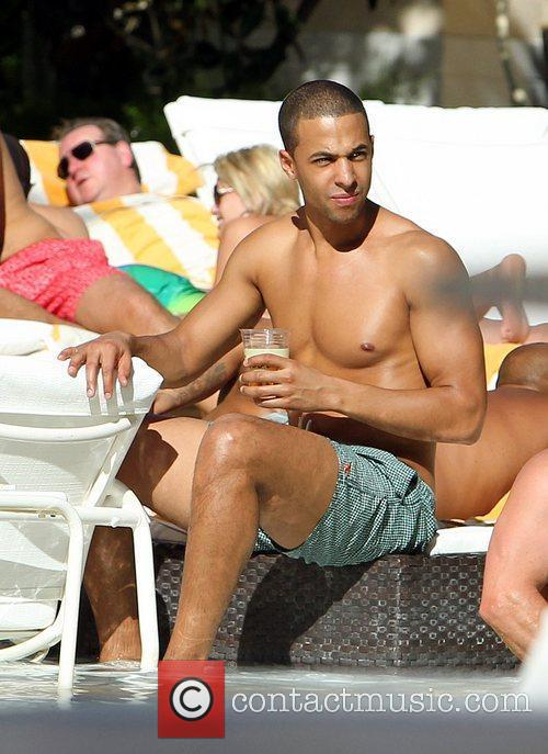 The JLS boys hang out at the pool...