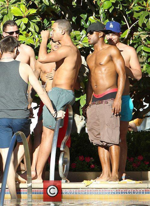 Marvin Humes is egged on by bandmates Oritse...