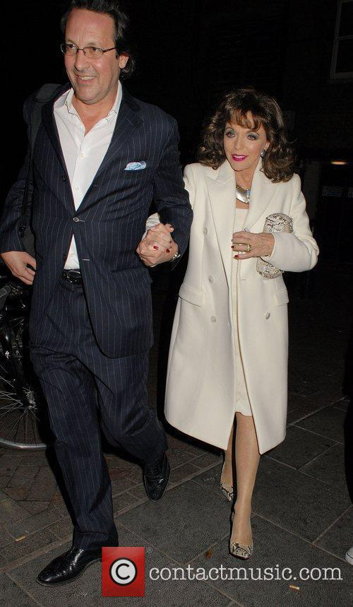 Joan Collins and Percy Gibson after her show,...