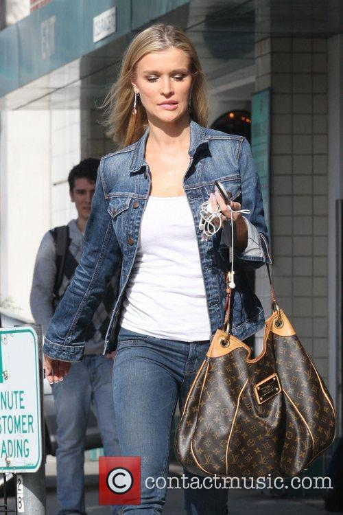 Joanna Krupa wearing double denim while out and...