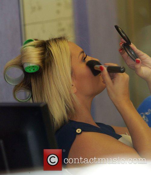 Sam Faiers applies make-up while at an estate...