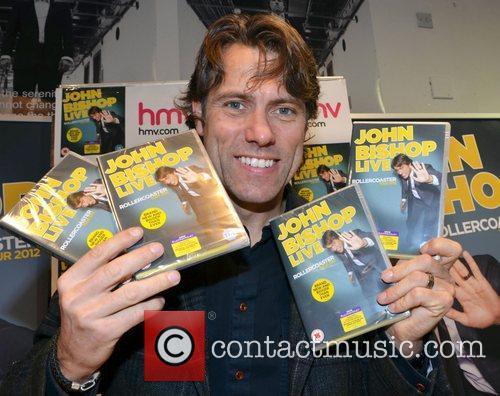 Signs copies of his dvd entitled 'John Bishop...