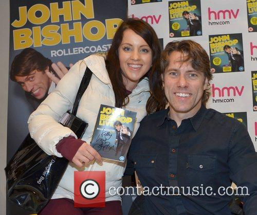 John Bishop signs copies of his dvd entitled...