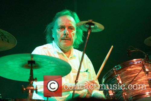 Former Status Quo drummer John Coghlan performs with...