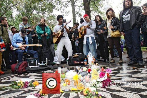 Fans gather at the Strawberry Fields memorial for...