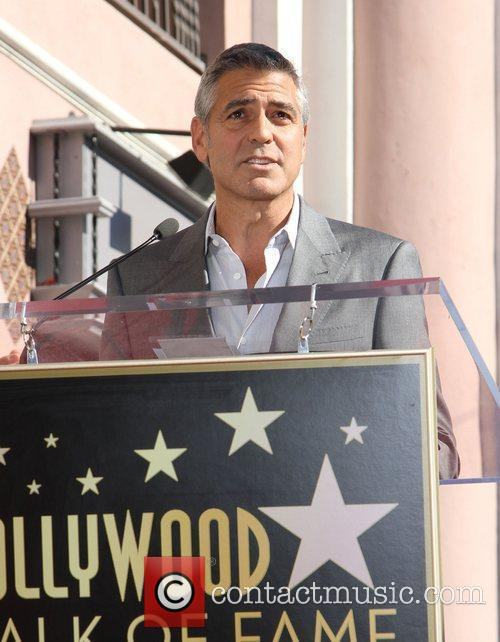 Attending the John Wells Hollywood Walk Of Fame...
