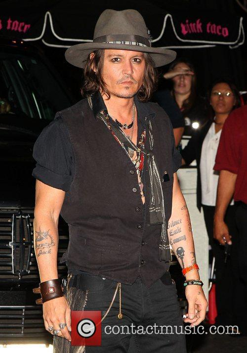 Johnny Depp arrives at Aerosmith party