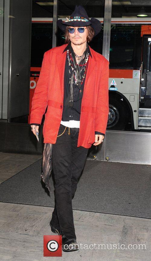 johnny depp arrives at tokyo international airport 3876102