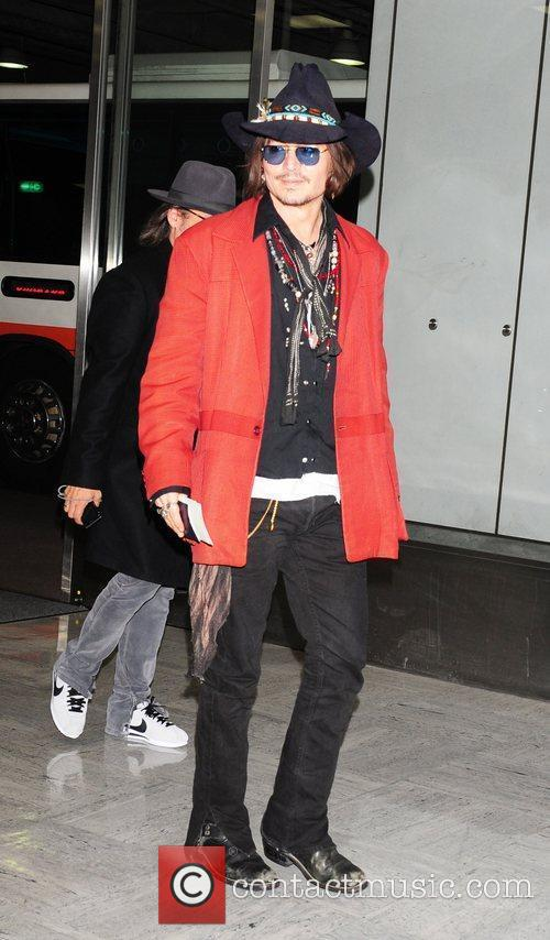 johnny depp arrives at tokyo international airport 3876104