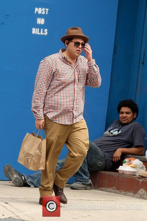 Jonah Hill carrying a take-out bag from Chipotle...