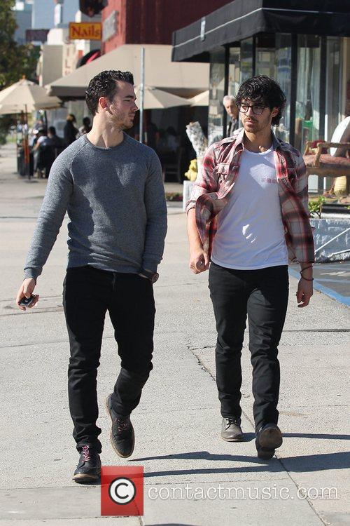 Joe Jonas and Kevin Jonas  walk back...
