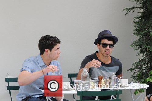 Joe Jonas and Nick Jonas  having a...