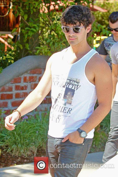 The Jonas Brothers seen exiting a restaurant in...