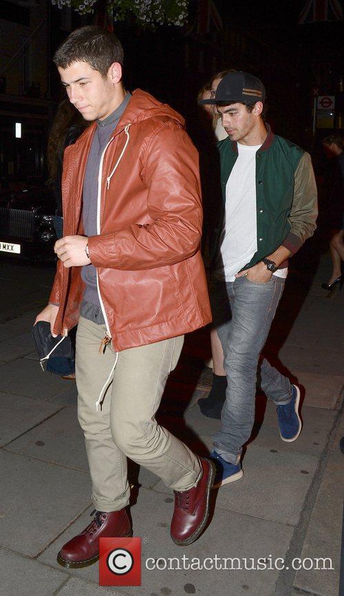 Kevin and Joe Jonas leave the exclusive Hakkasan...