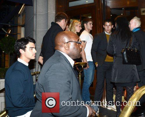 Kevin and Joe Jonas arrive back at the...