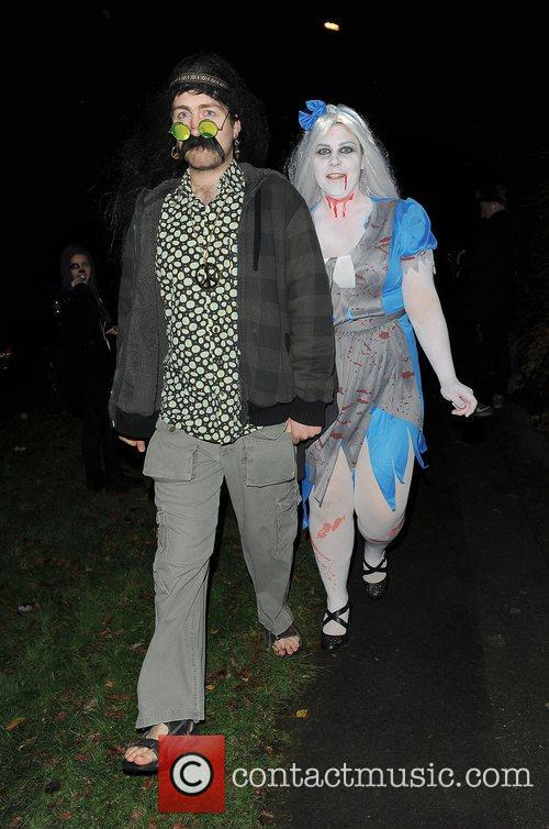 Guests leaving a Halloween party held at the...