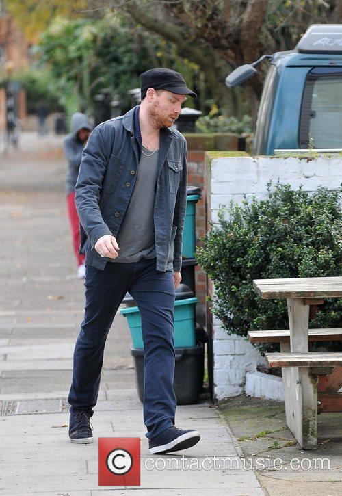 jonny buckland of coldplay walking to the 3635873