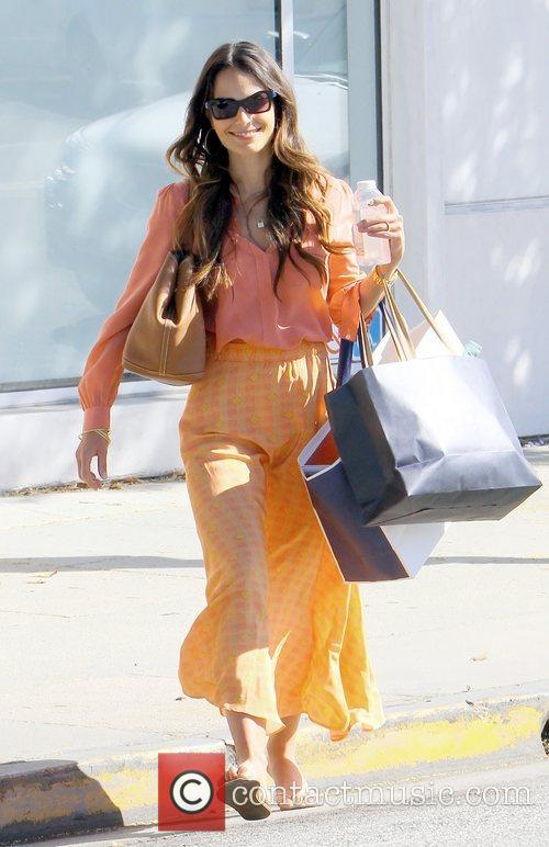 A stylish looking Jordana Brewster carries bags of...