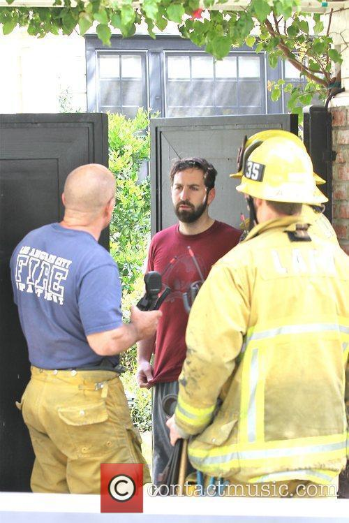 Josh Kelley Firefighters arrive to the home of...