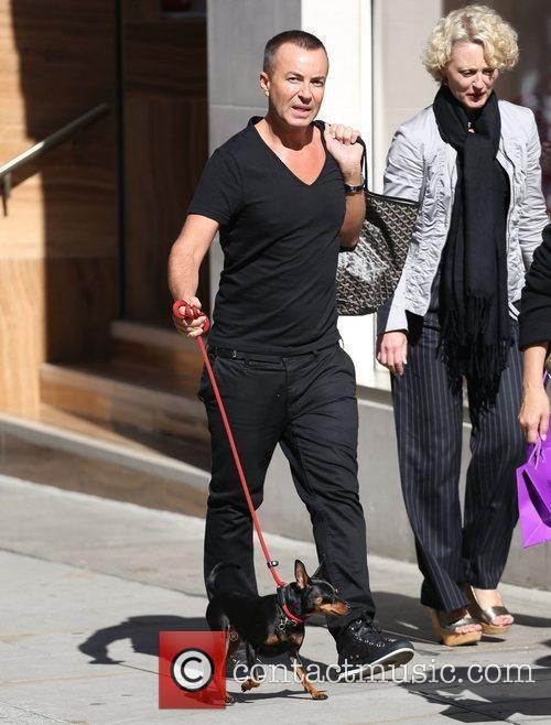 Julien MacDonald walks his dog on New Bond...