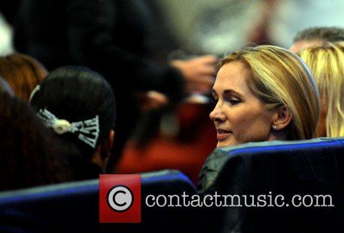 Miranda Rinsjburger watches her husband Julio Iglesias perform...