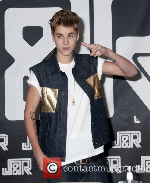 Justin Bieber signing autographs at JR Music World...