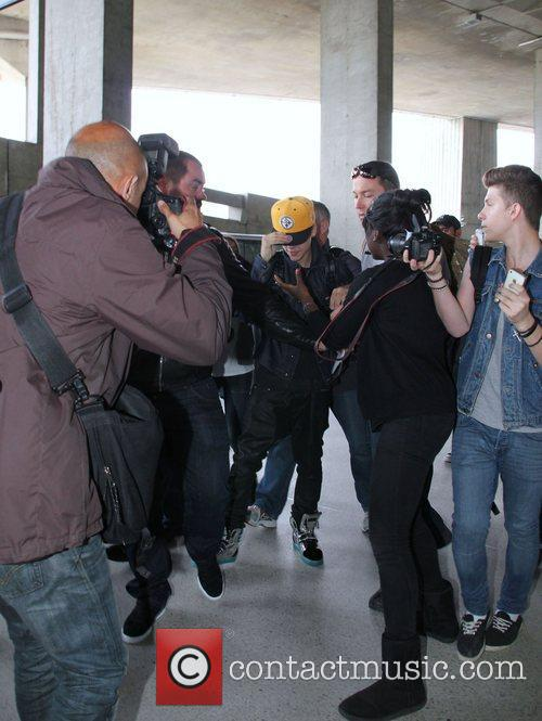 Justin Bieber is mobbed by fans as he...