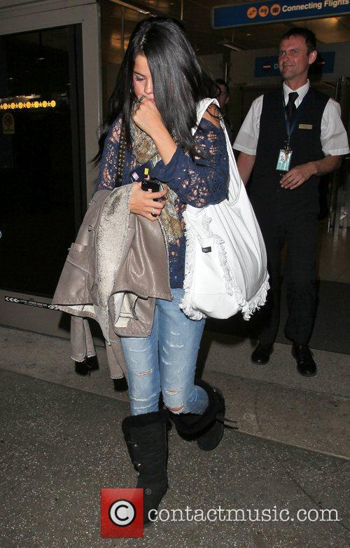 Selena Gomez arrives at LAX airport to be...