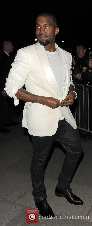 Kanye West returning to his hotel.