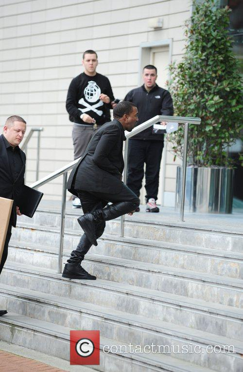 Kanye West arriving at his hotel Manchester, England