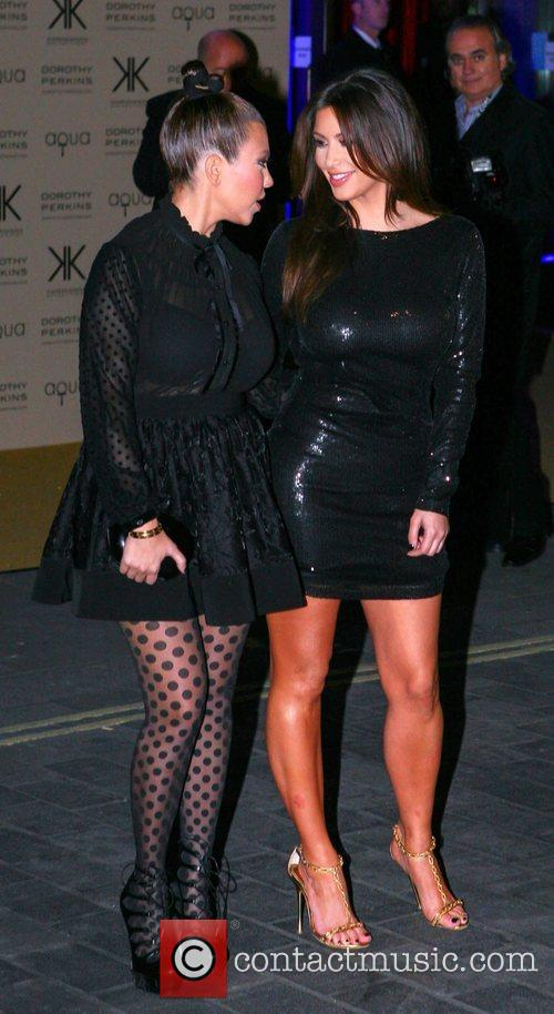 Kourtney Kardashian and Kim Kardashian 6