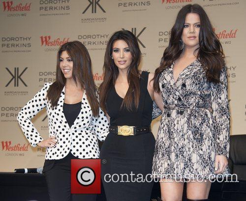 Kourtney Kardashian, Khloe Kardashian Odom and Kim Kardashian 6