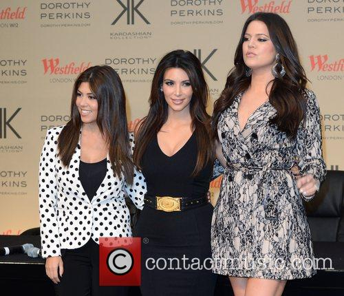 Kourtney Kardashian, Khloe Kardashian Odom and Kim Kardashian 9