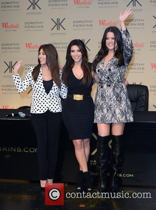 Kourtney Kardashian, Khloe Kardashian Odom and Kim Kardashian 11