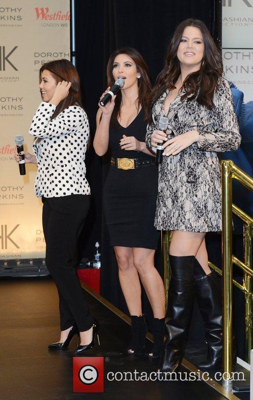 Kourtney Kardashian, Khloe Kardashian Odom and Kim Kardashian 12