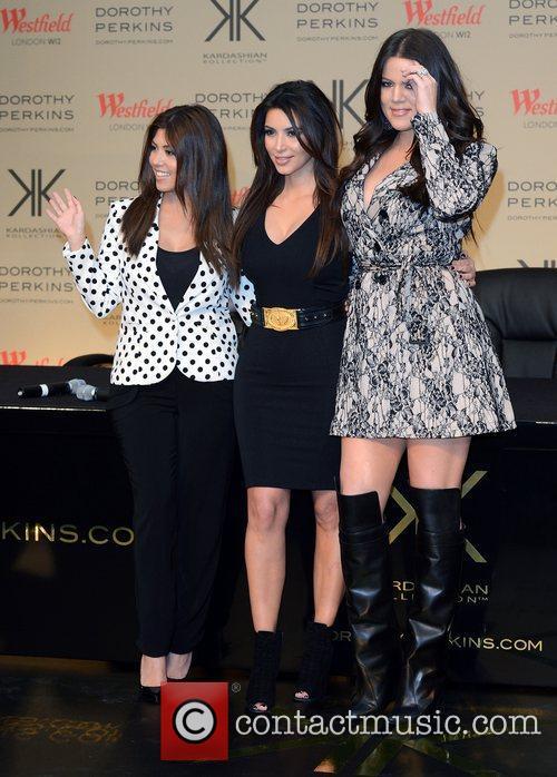 Kourtney Kardashian, Khloe Kardashian Odom and Kim Kardashian 8