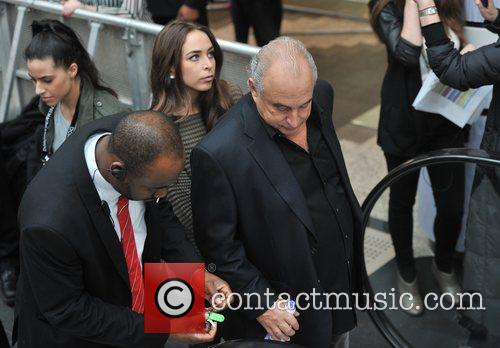 Sir Philip Green leads her daughter Chloe away...