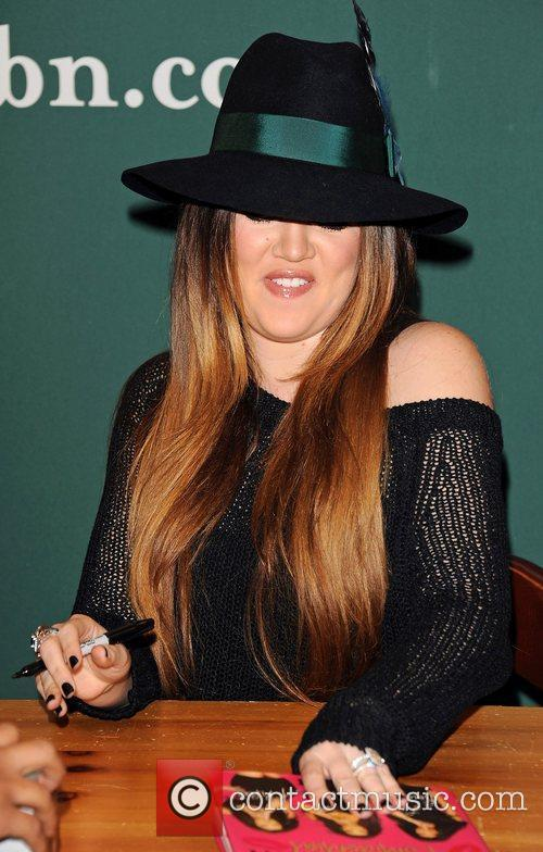 Kourtney and Khloe Kardashian sign copies of of...