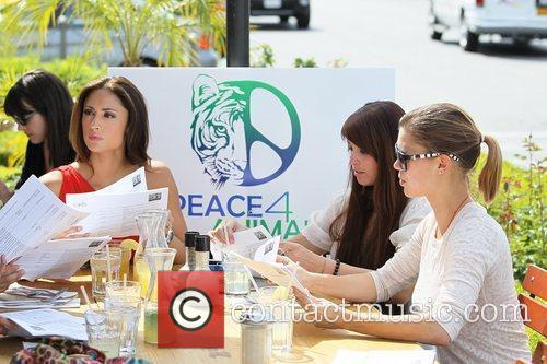 Model Katie Cleary  protests the sale of...