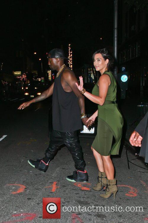 Kanyee West and Kim Kardashian leaving the Al...