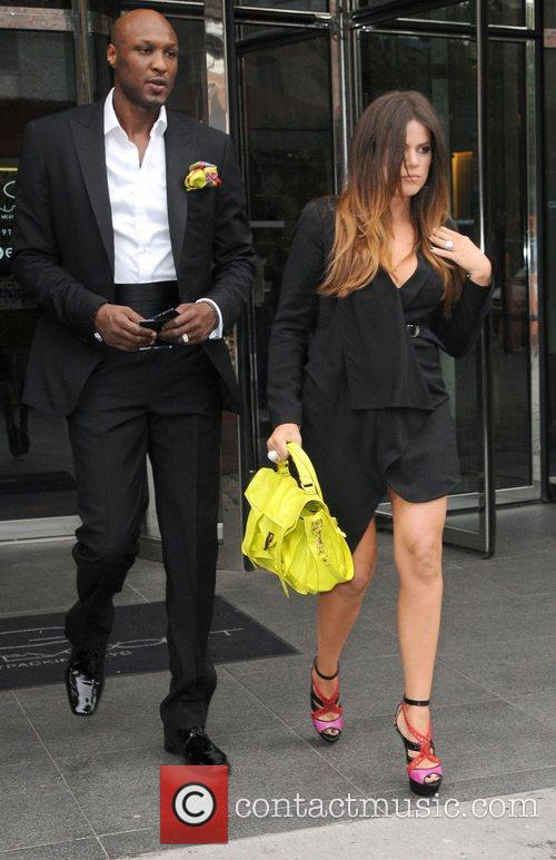 Khloe Kardashian with Lamar Odom leaving her hotel...