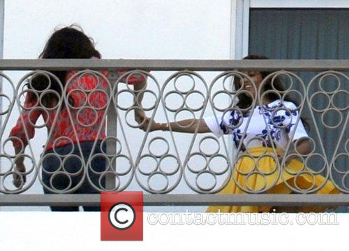 Kourtney Kardashian and Khloe Kardashian on the balcony...
