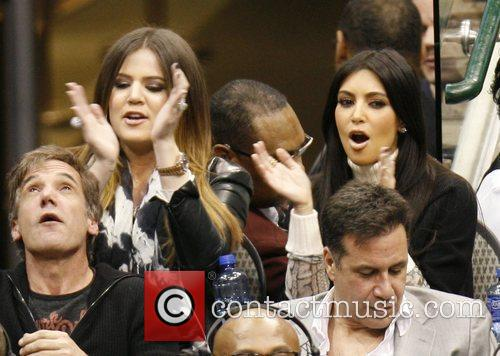 Khloe Kardashian and Kim Kardashian 16