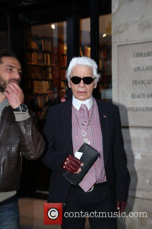 Karl Lagerfeld leaves the Galignani book store in...