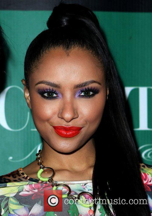 Kat Graham walks the red carpet at Chateau...