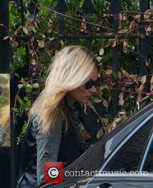 Kate Moss leaves her home and heads to...