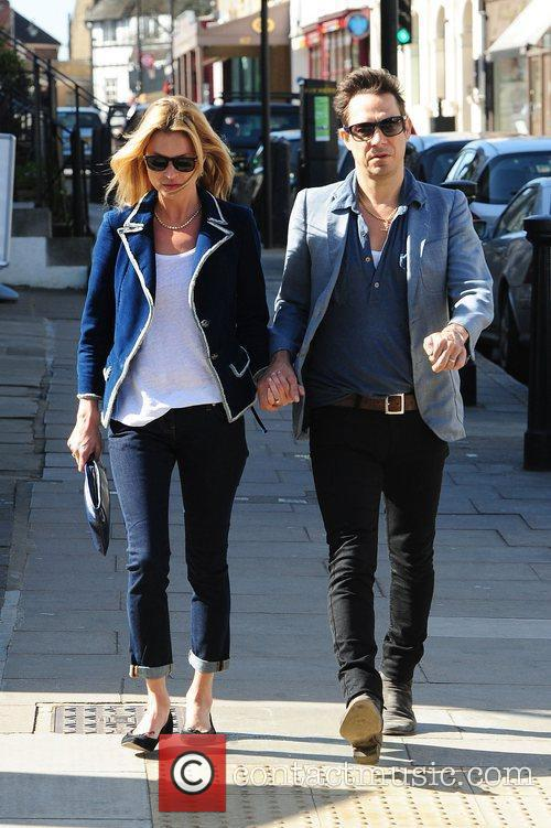 Kate Moss and Jamie Hince walking in north...