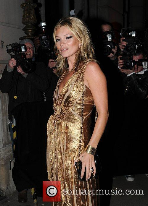 Kate Moss in a gold dress at the...